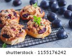 homemade pastry with plums and... | Shutterstock . vector #1155176242