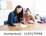 homeschooling mother assisting...   Shutterstock . vector #1155179998