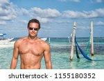man on sea beach in costa maya  ... | Shutterstock . vector #1155180352