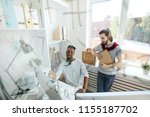 two hipster guys in casualwear... | Shutterstock . vector #1155187702