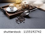 coffee beans and a cup of latte ... | Shutterstock . vector #1155192742