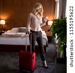 young woman with luggage in... | Shutterstock . vector #1155195622