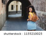 young mixed woman with curly... | Shutterstock . vector #1155210025