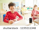 serious schoolboy with afro... | Shutterstock . vector #1155211348