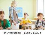 professional teacher with blond ... | Shutterstock . vector #1155211375