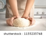 Woman Kneading Dough For Pastr...