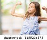 brunette hispanic girl showing... | Shutterstock . vector #1155236878