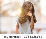 brunette hispanic girl wearing... | Shutterstock . vector #1155236968
