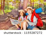 two kids in forest navigate... | Shutterstock . vector #1155287272