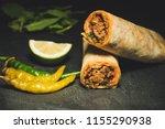 delicious turkish kebab tantuni | Shutterstock . vector #1155290938