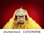 a silly ugly man wearing a tin... | Shutterstock . vector #1155296908