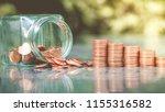 saving money concept.coin in... | Shutterstock . vector #1155316582