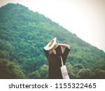beautiful woman relaxing on... | Shutterstock . vector #1155322465