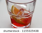 a glass of alcoholic drink | Shutterstock . vector #1155325438
