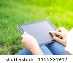 close up woman using tablet... | Shutterstock . vector #1155334942