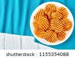 crispy potato waffles fries ... | Shutterstock . vector #1155354088