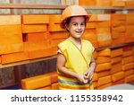 a child  a girl in a helmet on... | Shutterstock . vector #1155358942
