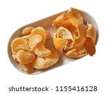tangerine on plate.  preparing...   Shutterstock . vector #1155416128