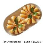 tangerine on plate.  preparing...   Shutterstock . vector #1155416218