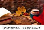 coffee in an enamel mug  woolen ... | Shutterstock . vector #1155418675