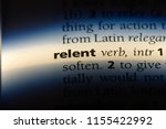 Small photo of relent word in a dictionary. relent concept.