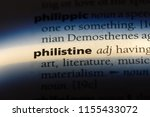 Small photo of philistine word in a dictionary. philistine concept.