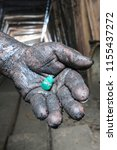miner's hand with colombian... | Shutterstock . vector #1155437272