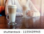 latte macchiato drink in tall... | Shutterstock . vector #1155439945