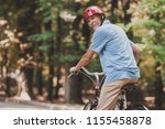 old man riding on bicycle in... | Shutterstock . vector #1155458878