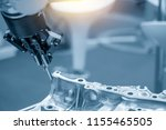 The robot for manufacturing  the aluminum automotive part .The automotive part quality control concept. - stock photo