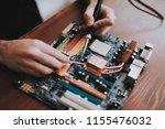 close up. young man repairing...   Shutterstock . vector #1155476032