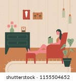 a girl is sitting on a couch... | Shutterstock .eps vector #1155504652