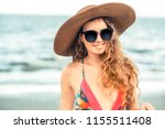 happy young woman wearing... | Shutterstock . vector #1155511408