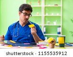 young doctor sitting in...   Shutterstock . vector #1155535912