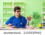 young doctor sitting in...   Shutterstock . vector #1155535942