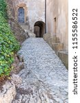 an aile leading to an medieval... | Shutterstock . vector #1155586522