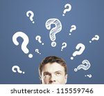 businessman with question mark  on a blue background - stock photo