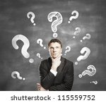 man with question mark  on a gray background - stock photo