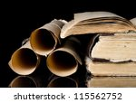 many scrolls and old books on... | Shutterstock . vector #115562752