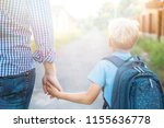 father holding hand little son... | Shutterstock . vector #1155636778