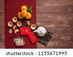 Small photo of Flat lay Chinese new year food and drink on wooden table top. Texts appear in image: Prosperity, Spring. Text space image.