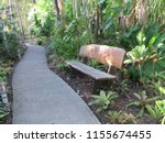 Wooden Bench On Path Through...