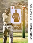 gun shooting competition. lady... | Shutterstock . vector #1155695422