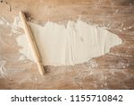rolling pin and flour on wooden ... | Shutterstock . vector #1155710842