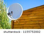 satellite antenna on a wooden... | Shutterstock . vector #1155752002