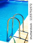 pool stairs with blue water | Shutterstock . vector #1155752572