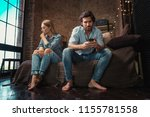 couple at home with smartphone... | Shutterstock . vector #1155781558