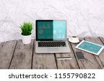 analyzing statistics on laptop... | Shutterstock . vector #1155790822