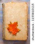 old vintage books on wooden... | Shutterstock . vector #1155810115