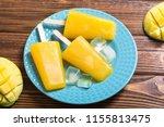 homemade mango popsicle .... | Shutterstock . vector #1155813475